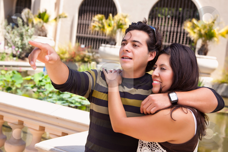 Attractive Hispanic Couple Enjoy the Outdoors stock photo, Attractive Hispanic Couple Portrait Enjoying Each Other Outdoors. by Andy Dean
