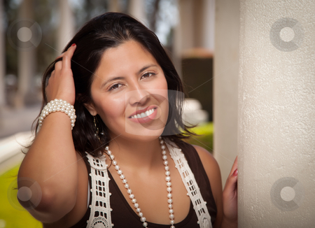 Attractive Hispanic Young Woman Outside stock photo, Attractive Smiling Hispanic Young Adult Woman Portrait Outside. by Andy Dean