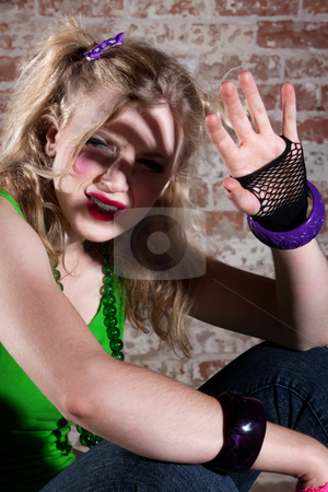 Young Punk Rocker stock photo, Young punk rocker shielding her face from the light by Scott Griessel