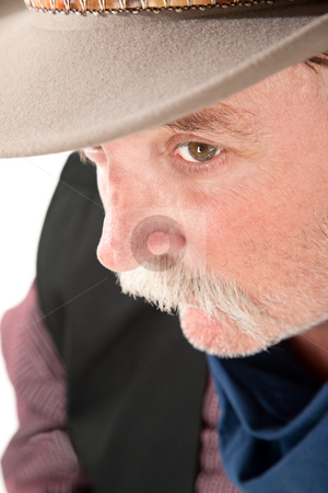Cowboy closeup stock photo, Close-up of older man in western outfit and hat by Scott Griessel