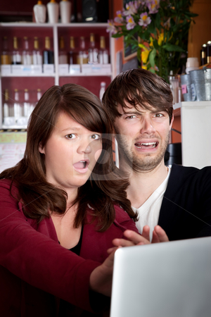 Caught stock photo, Caught viewing something naughty on a laptop in a cafe by Scott Griessel