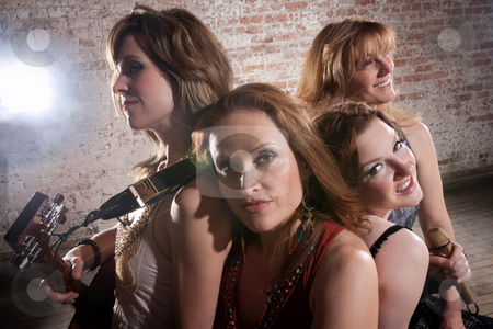 Female musicians stock photo, Female musicians rest after a long practice session by Scott Griessel