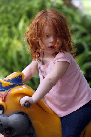Cute Redhead Girl on a Playground (14) stock photo, An adorable two-year-old redhead girl on a playground. by Carl Stewart