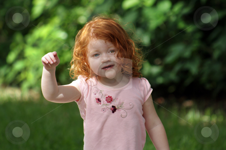 Cute Redhead Girl on a Playground (16) stock photo, An adorable two-year-old redhead girl on a playground. by Carl Stewart
