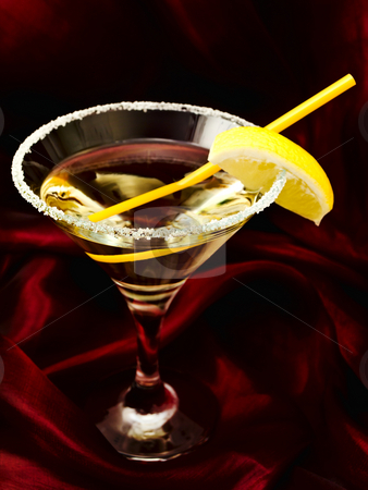 Cocktail stock photo, Cocktail with lemon over silk drapery by Sergej Razvodovskij