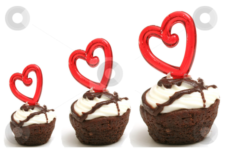 Three heart brownies in a row stock photo, Three heart brownies in a row by Andi Berger