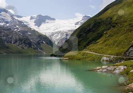 Green big mountain lake stock photo, Green big mountain lake high in the mountains with glacier view by Karin Claus