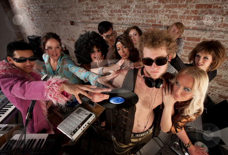 1970s Disco Music Party stock photo, DJ crowded by fans and requests at a party by Scott Griessel