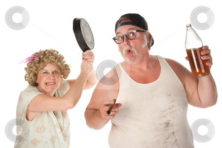 Pan to head stock photo, Woman readies a pan to drunken husband's head by Scott Griessel