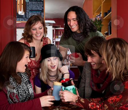 Toast stock photo, Six friends making a toast around a table by Scott Griessel