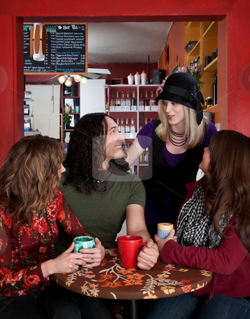 Friends together stock photo, Four friends together at a coffee house by Scott Griessel