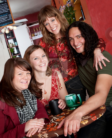 Four friends  stock photo, Four friends smiling and enjoying each others company at a cafe by Scott Griessel