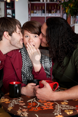 Surprise kiss stock photo, Woman caught in a surprise love triangle by Scott Griessel