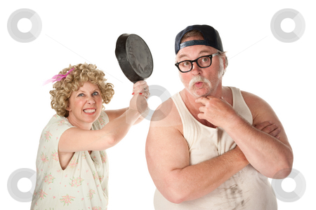 Wife readies to strike her clueless husband's head with a pan stock photo, Wife readies a pan to her clueless husband's head by Scott Griessel