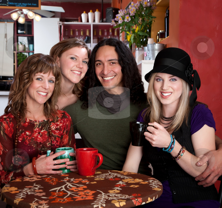 Four Friends stock photo, Four smiling friends enjoying coffee in a cafe by Scott Griessel