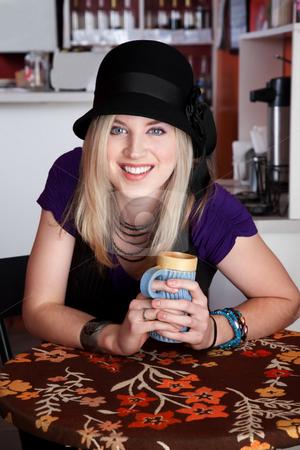 Pretty Girl stock photo, Pretty girl smiling with aqua ceramic mug in a bistro by Scott Griessel
