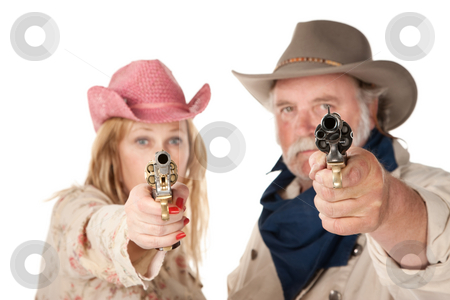 Point blank range stock photo, Couple in western wear pointing pistols with serious faces by Scott Griessel