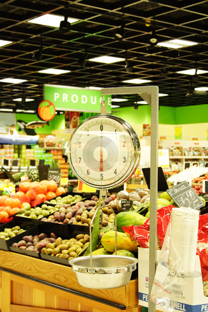 Weight scale stock photo, A weight scale in a produce section of a grocery store by Suprijono Suharjoto