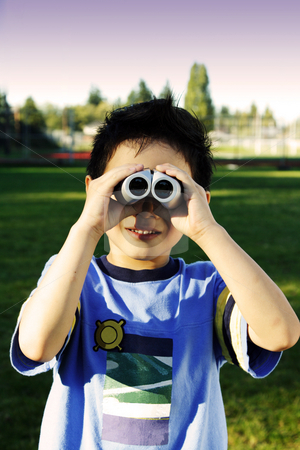 Happy kid stock photo, A boy looking through a binocular by Suprijono Suharjoto