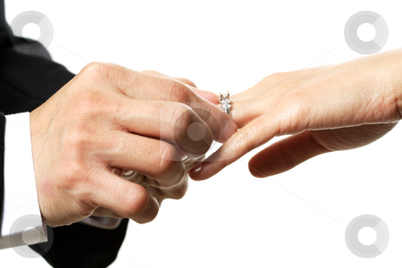 Wedding stock photo, The groom and bride exchanging rings during wedding ceremony by Suprijono Suharjoto