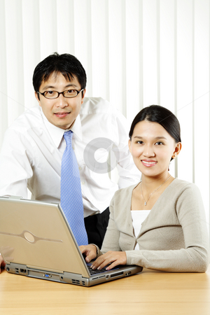 Business partners stock photo, A businessman and a businesswoman in an office by Suprijono Suharjoto
