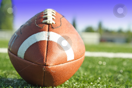 American football stock photo, A shot of an american football on a football field by Suprijono Suharjoto
