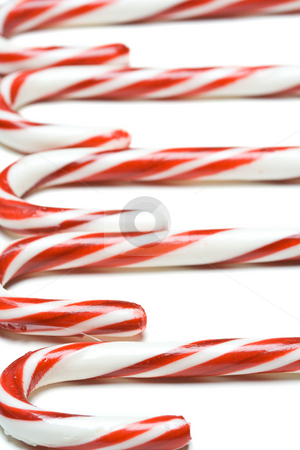 Christmas candy cane stock photo, A shot of christmas candy cane in a row by Suprijono Suharjoto
