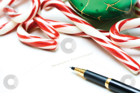Christmas greeting card stock photo, A shot of a christmas greeting card with candy canes and christmas ornament by Suprijono Suharjoto