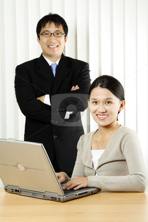 Business team stock photo, A businesswoman and a businessman in an office by Suprijono Suharjoto