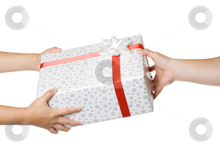 Gift exchange stock photo, An isolated shot of people exchanging gifts by Suprijono Suharjoto
