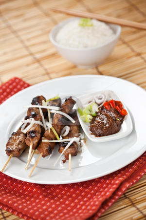 Pork satay stock photo, A shot of pork satay dish on white plate by Suprijono Suharjoto