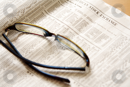Stock prices stock photo, Reading stock prices on newspaper by Suprijono Suharjoto