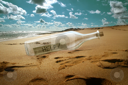 Help message in a bottle stock photo, Help message in a bottle on beach by Giordano Aita