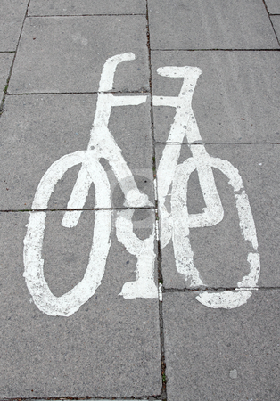 White cycle lane sign on paving slabs. stock photo, White cycle lane sign on paving slabs. by Stephen Rees