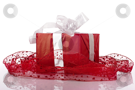 Christmas box stock photo, Beautiful red Christmas box isolated on white with reflection by ikostudio