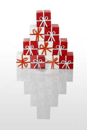 Christmas gifts stock photo, Pyramid made with small gift boxes isolated on white with reflection by ikostudio