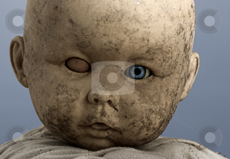Baby dool stock photo, Close-up of baby doll with only on eye opened by ikostudio
