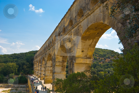 Pont du Gard stock photo, Der Pont du Gard ist eine r?mische Aqu?duktbr?cke  im S?den Frankreichs, nahe der Ortschaft Remoulins im D?partement Gard. - The Pont du Gard is an aqueduct in the South of France constructed by the Roman Empire, and located in Vers-Pont-du-Gard near Remoulins, in the Gard  d?partement. by Wolfgang Heidasch