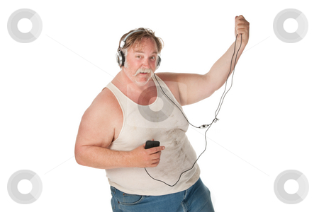 Man dancing to music on handheld audio device stock photo, Fat man with mp3 player dancing to music by Scott Griessel