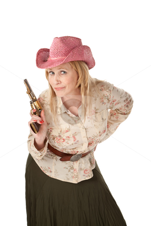 Cowgirl on white background stock photo, Woman with pink cowboy hat playing with a pistol by Scott Griessel