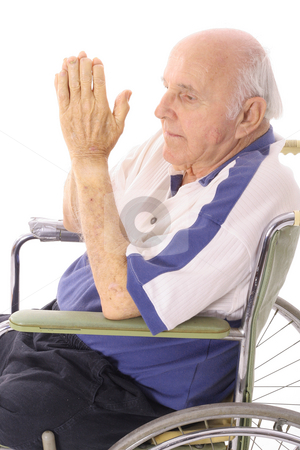 Handicap senior praying in wheelchair stock photo, Shot of a handicap senior praying in wheelchair by Andi Berger