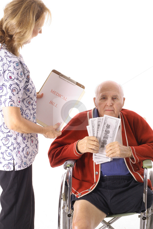 Elderly handicap senior paying medical bill stock photo, Elderly handicap senior paying medical bill by Andi Berger