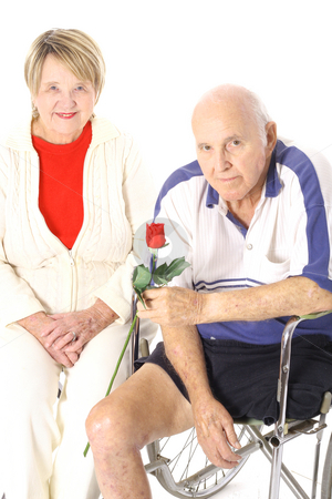 Handicap happy elderly couple stock photo, Shot of a handicap happy elderly couple by Andi Berger