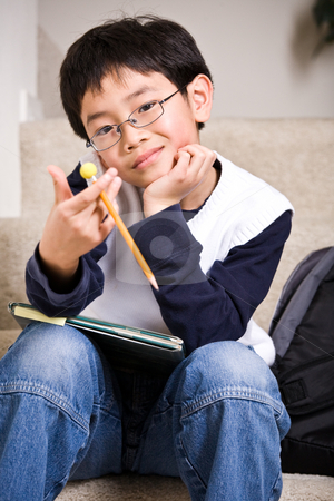 Young student stock photo, A shot of an asian kid carrying books by Suprijono Suharjoto