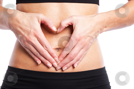 Fitness woman stock photo, An isolated shot of a woman making a heart sign on her tummy by Suprijono Suharjoto