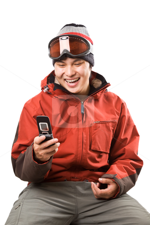 Snowboarder stock photo, An isolated shot of an asian snowboarder texting with his cellphone by Suprijono Suharjoto
