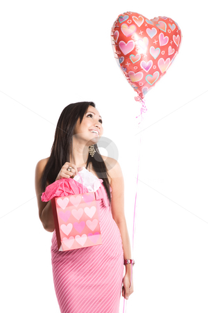 Beautiful valentine asian woman stock photo, A beautiful asian woman carrying a heart-shaped balloon and valentine gifts by Suprijono Suharjoto