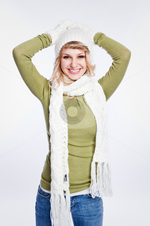 Beautiful caucasian winter woman stock photo, A portrait of a happy beautiful caucasian winter woman by Suprijono Suharjoto