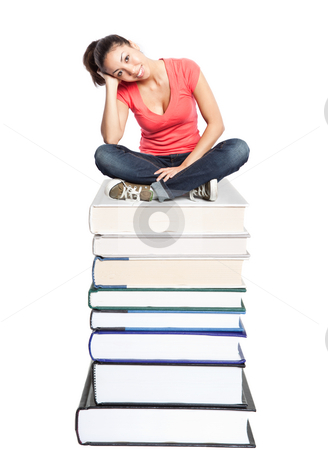Beautiful college student stock photo, An isolated shot of a beautiful black college student sitting on a stack of books by Suprijono Suharjoto
