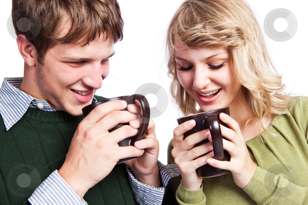 Caucasian couple holding coffee cups stock photo, A portrait of a happy beautiful caucasian couple holding coffee cups by Suprijono Suharjoto